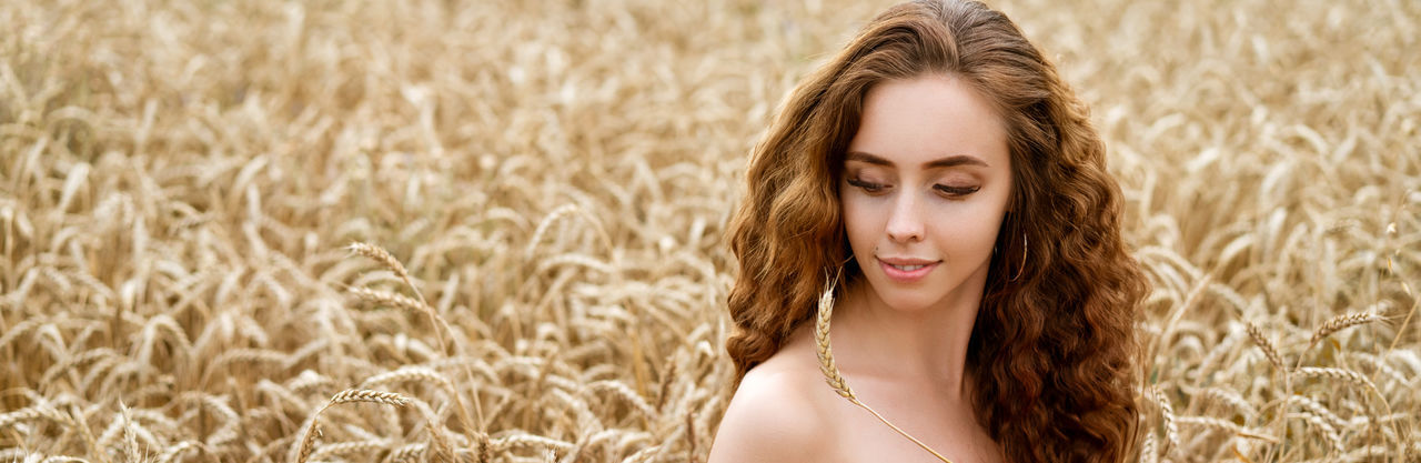Portrait of smiling young woman in field