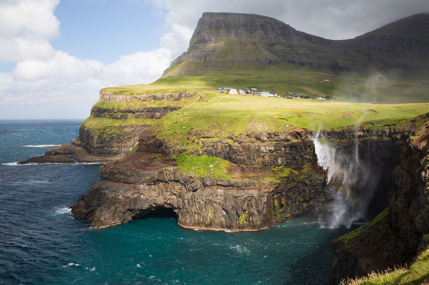 EyeEm Nature Lover Gasadalur Tadaa Community Beauty In Nature Cliff Day Eroded Faroe Islands Idyllic Land Mountain Nature No People Non-urban Scene Outdoors Rock Rock - Object Rock Formation Scenics - Nature Sea Sky Solid Tranquil Scene Water Waterfall