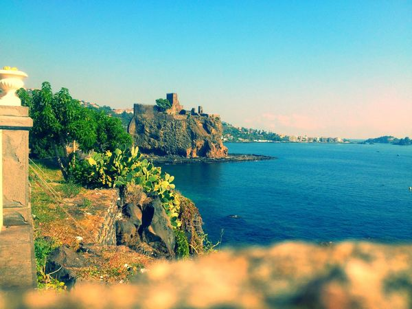 Castello di Aci. Ottobre 2013 Aci Castello Architecture Beauty In Nature Blue Building Exterior Built Structure Clear Sky Day History Nature No People Outdoors Scenics Sea Sicilia Siciliabedda Sicily Sky Tree Water