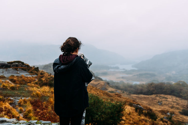 Girl in misty landscape Misty Viewpoint Woman Girl Millennial Mountain Rear View Real People Standing Leisure Activity Scenics - Nature One Person Lifestyles Beauty In Nature Nature Tranquil Scene Environment Landscape Tranquility Mountain Range Three Quarter Length Activity Outdoors Looking At View Molls Gap Sky Non-urban Scene