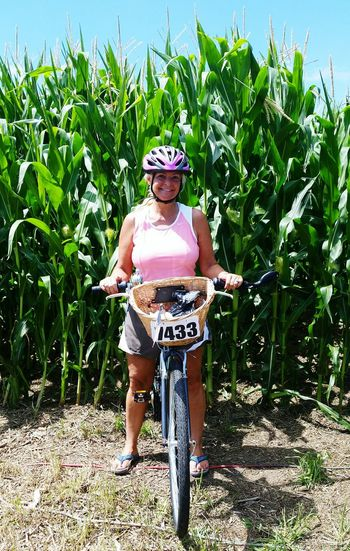 RAGBRAI Growth Day One Person Full Length Agriculture Field Outdoors One Woman Only Plant Adult Ragbrai Cornfield Corn Color Green Helmets Cyclists Iowa Farms Women People Nature Real People Sky
