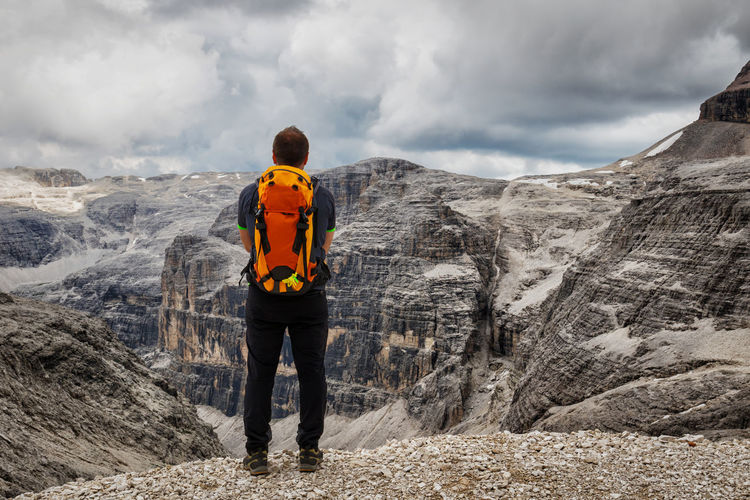 Adventure Backpack Beauty In Nature Cloudy Dolomites, Italy Dolomiti Hiker Hiking Italy Landscape Leisure Activity Lifestyles Man Mountain Nature Non-urban Scene Outdoors Rock Scenics Sella Group Standing Tranquil Scene Tranquility View People And Places