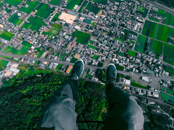 Low Section Of Man Flying Above City