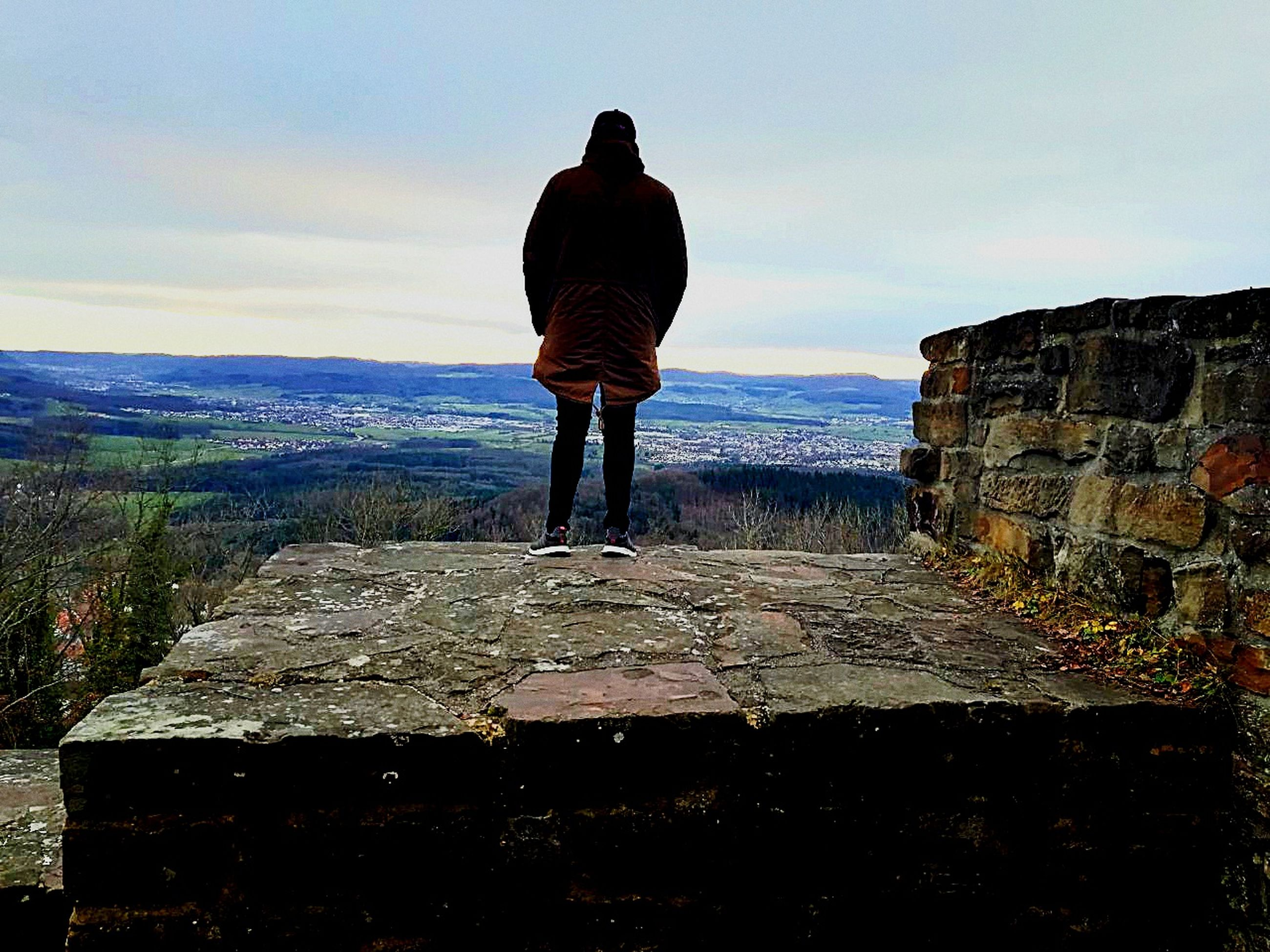 rear view, real people, one person, sky, men, full length, outdoors, standing, nature, leisure activity, mountain, day, one man only, landscape, scenics, beauty in nature, people