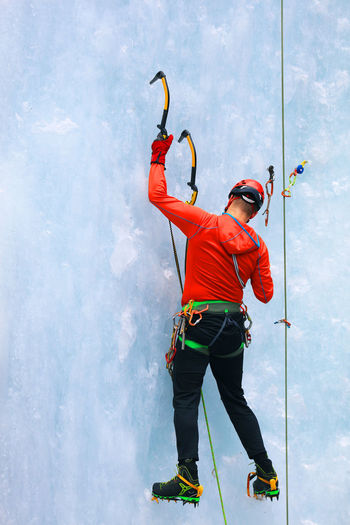 Full Length Of Man Climbing Glacier