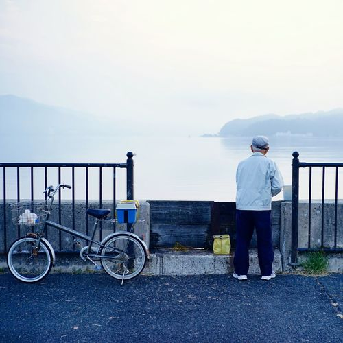 50mm CyclingUnites Tranquil Scene Serenity Fisherman Beauty In Nature Japan Photography Leica Lens Minimalism Nature Loneliness Outdoors People From Behind People Photography Quiet Moments Seascape Travel Photography Soft Colors  Softness Square Format Lovers Enjoy The Silence Fine Art Japan Sea My Favorite Photo Daybreak