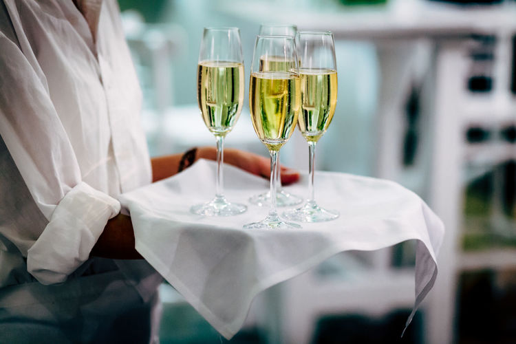 Glass of wine glasses on table at restaurant