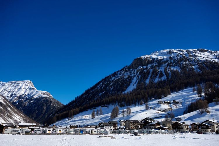 Snow Cold Temperature Winter Mountain Sky Beauty In Nature Scenics - Nature Mountain Range Snowcapped Mountain Nature Clear Sky Blue Building Exterior Architecture Environment Day Built Structure Building Landscape No People Outdoors