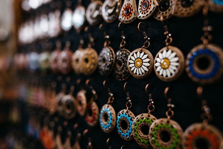 Choice Large Group Of Objects For Sale Variation No People Retail  Art And Craft Hanging Market Jewelry Close-up Retail Display Selective Focus Abundance Craft Focus On Foreground Still Life Indoors  Store Arrangement Sale Ornate Pendant Pendentive
