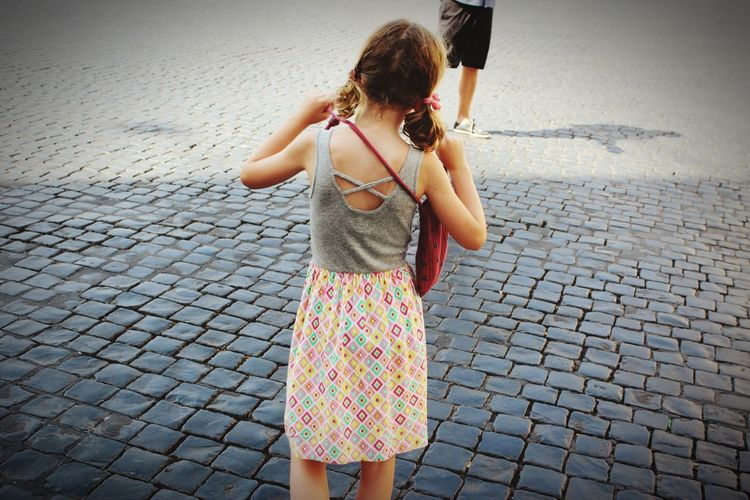 Rear View Real People Childhood Outdoors One Person Casual Clothing Girls Standing Day Elementary Age Walking Three Quarter Length