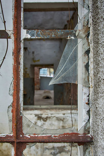 Abandoned Metal Architecture Old Damaged Rusty Run-down Deterioration Built Structure Decline Building No People Obsolete Weathered Day Focus On Foreground Bad Condition Window Close-up Broken Outdoors Ruined Window Frame Exit Hope