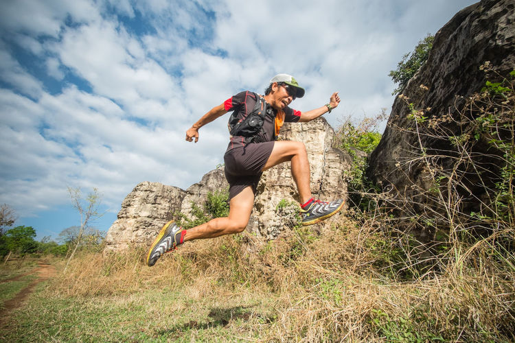 Action Sports Adventure Cloud - Sky Endurance Exercising Extreme Sports Full Length Jump Jumping Leisure Activity Low Angle View Motion One Man Only Outdoors People Recreation  Recreational Pursuit Sport Trailrunning Ultramarathon Vitality Young Adult