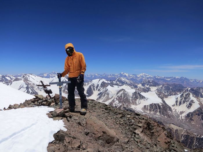 Man standing on mountain peak