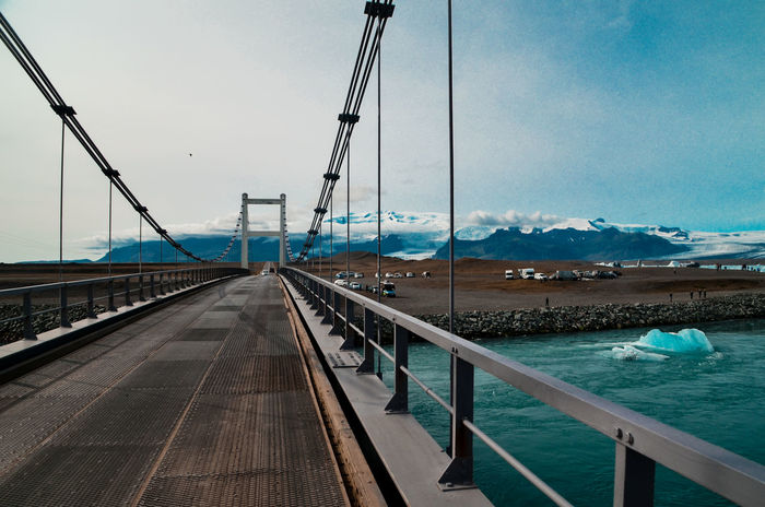 A shot of the Bridge spanning over the stream that connects Jokulsárlón, Icelands famous Glacier-Lagoon, to the sea where blocks of ice float into the ocean. Architecture Ice Iceland Travel Photography Travelling Amazing Destination Destination Direction Glacier Glacier Lagoon Iceland_collection Landscape Landscapephotography #landscapelover #landscape_captures #landscapes #landscape_photography #pixel_ig #landscape_hunter #landscape_lovers #landscapecaptures #landscapestyles_gf #landscape_specialist #landscapeporn #getlost #landscapephotomag #ig_landscape No People Outdoor Outdoors Polar  Railing Sky The Way Forward Travel Travel Destinations Water