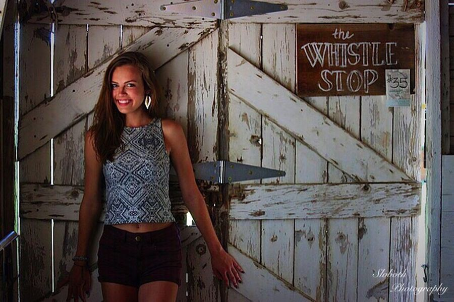 Whistle Shop Standing Lifestyles Casual Clothing Young Adult Young Women Person Long Hair Front View Day In Front Of Outdoors Barn Doors Crop Top Senior Senior Pictures  Senioryear Senior Year Junk Stock Junkstock Cute