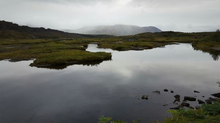 Pingvellir Water Nationalpark Unesco Iceland Reflection Tranquil Scene Scenics Tranquility Mountain Beauty In Nature Sky Nature Cloud - Sky Calm Non-urban Scene Standing Water Green Color Mountain Range Waterfront Growth No People Tourism Physical Geography