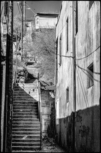 Buildings and Things in Miami, Arizona Stairs Steps And Staircases Black And White Photography Architecture Built Structure Building Exterior Building No People Day Residential District Old Abandoned Weathered Outdoors Wall - Building Feature Wall City Alley House Staircase Nature Run-down Direction
