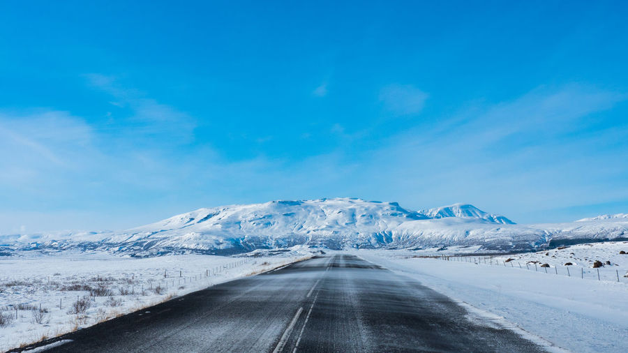 Snow Cold Temperature Sky Winter Road Beauty In Nature Scenics - Nature Mountain The Way Forward Direction Cloud - Sky Transportation Day Nature Tranquil Scene Landscape Environment Tranquility Snowcapped Mountain No People Diminishing Perspective Outdoors