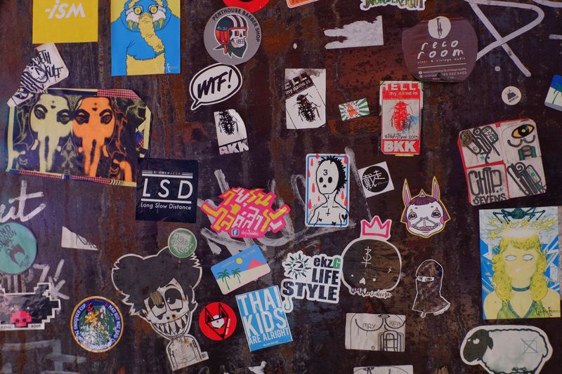 Bangkok Thailand, 9 December 2017 graffiti,street art and colorful sticker on the wall ,Bangkok Thailand Bangkok Cool Fashion Design Graphic Hipster Symbol Pattern Sign Backgrounds Wood Wall Messy Lifestyle Urban Sticker Art Street Art Graffiti Multi Colored Large Group Of Objects No People Childhood Indoors  Day Close-up
