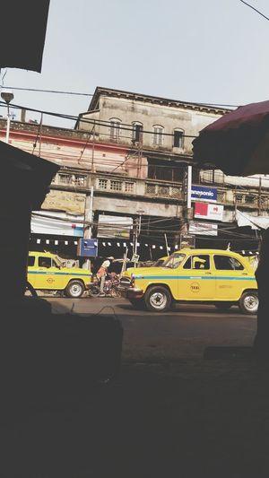 Busystreet Northkolkata Yellow Taxi Auto Sky KolkataStreets Transportation City Outdoors Architecture Day No People OldKolkata