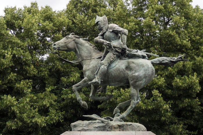 Statue of Bertrand du Guesclin on a horse in Caen, France Bertrand Du Guesclin Caen France Green Running Horse Statue Day Haute Normandie Helmet Horse Knight  Medieval Middle Ages Normandy Old Outdoors Sculpture Sword