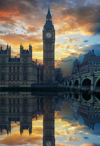 Reflection of big ben in city at sunset