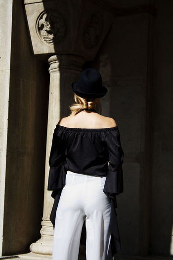 Rear View Of Woman Wearing Off Shoulder Top While Entering Historic Building