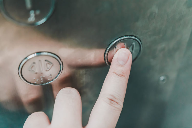 Close-up of hand holding glass against blurred background