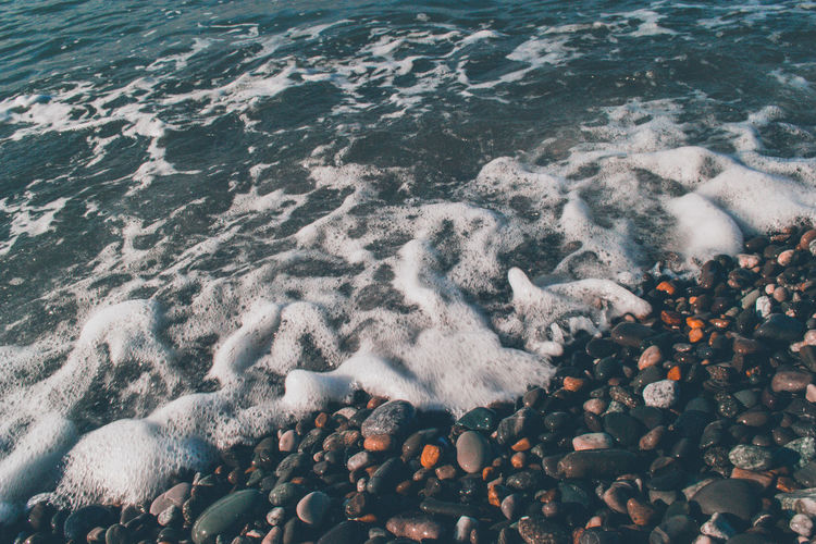 High angle view of pebbles on beach