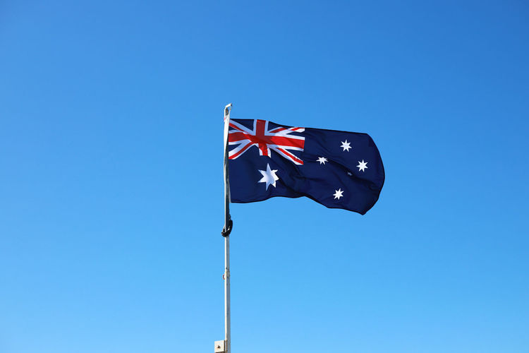 Low angle view of australian flag against clear blue sky
