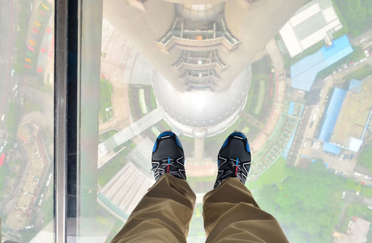 Looking down, while standing on the glass of Oriental Pearl Tower, Shanghai, China Adrenaline China Dangerous Down Glass Human Body Part Human Leg Indoors  Joggers Khaki Leisure Activity Lifestyles Look Down Low Section Men One Person Oriental Pearl Tower Out Of The Box Personal Perspective Perspective See Through Shanghai Shoe Shoes Standing