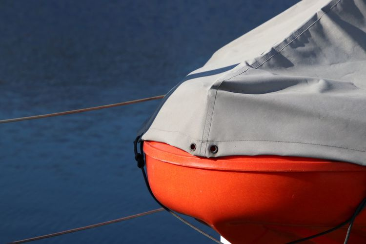 Close-up of boat against sea