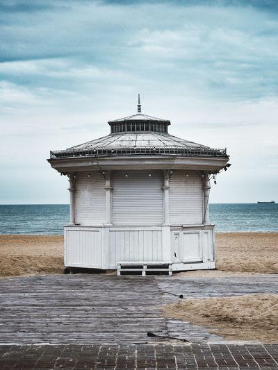 Temporarh closed stylish kiosk standing at the beach
