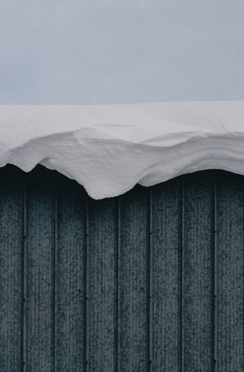 Snow hanging off roof.