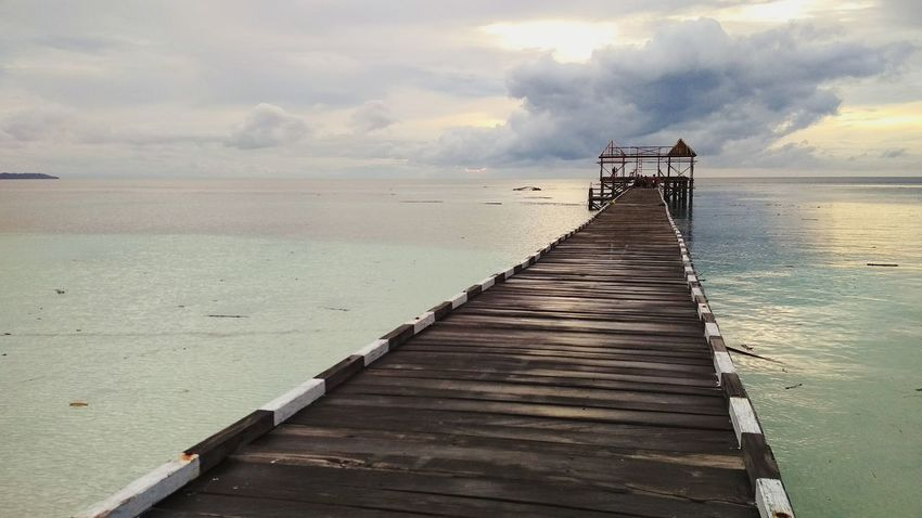 Dermaga Maratua Island INDONESIA Borneo Bridge Pier Sea Wood - Material Beach Water Jetty Cloud - Sky Landscape Sky Outdoors Summer Tranquility Horizon Over Water Vacations Sunset Nature Travel Destinations Scenics Day