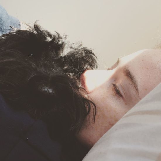 One Person Real People Dog Pets Domestic Animals Indoors  Mammal Lifestyles Bed Day Close-up Animal Themes Young Adult People Siesta Family Love