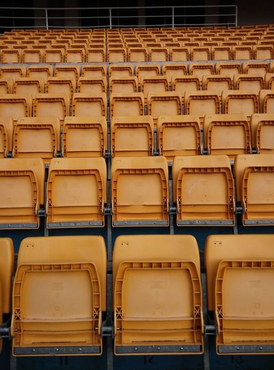 Full Frame Shot Of Empty Chairs At Stadium