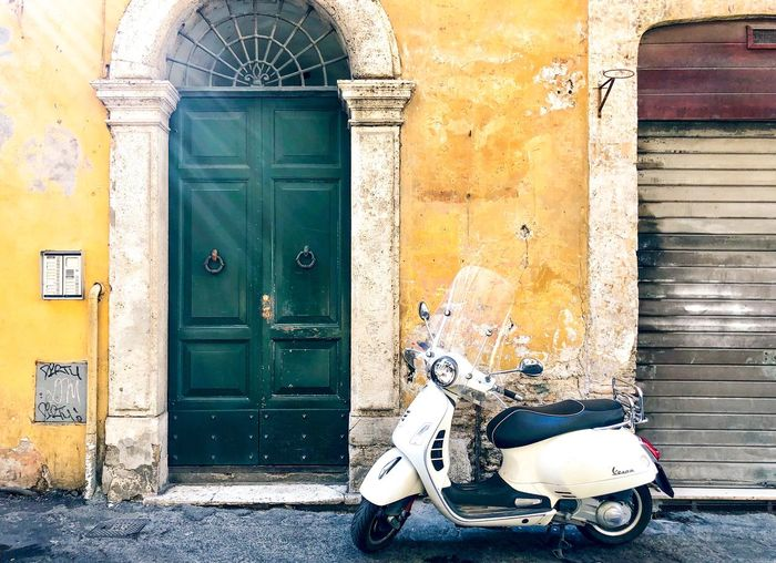 Italian Mood Streetphotography Dolce Vita European Union Yellow Color Piaggio Vespa Touristic Place Italianstyle 50 Special Italy Roma Entrance Door Architecture Building Exterior Built Structure Closed Day City