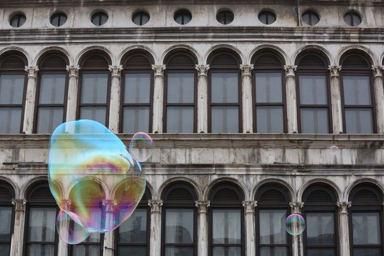 Soap bubbles with building in background