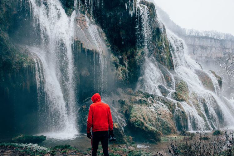 Real People Traveling Adventure Tourist Exploring Travel Travel Destinations Frozen Waterfall Waterfalls Cold Temperature Winter Tourist Attraction  Water Spraying Waterfall Motion Men Power In Nature Red Rear View Long Exposure Splashing RainDrop Monsoon Drop Wet Dew Droplet Weather