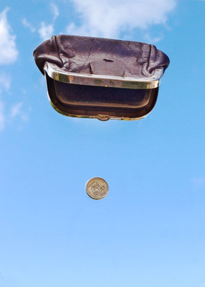 Low angle view of kite against blue sky