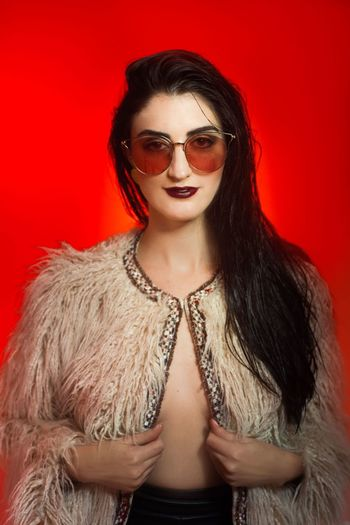 Nikita Red Fashion Young Adult Women Studio Shot Hairstyle Beautiful Woman Colored Background Portrait Red Background Young Women Beauty Long Hair Glasses One Person Hair Indoors  Glamour Adult