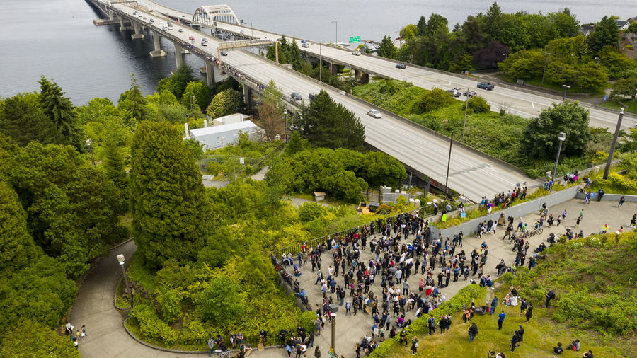 High angle view of people on road by trees in city