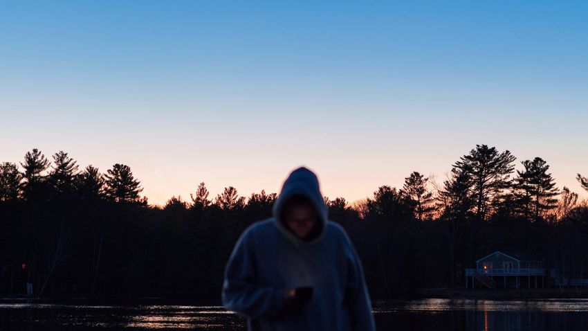 Hooded Shirt Hood - Clothing One Person Tree Real People Men Clear Sky Front View Sunset Standing Lifestyles Outdoors Silhouette Sky Nature One Man Only Day Adult People Close-up