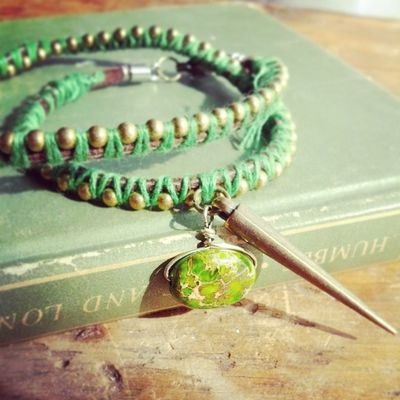 Green and antique gold wrap bracelet with jasper bead and charm Artisans Armcandy Wrapbracelet Bohojewelry backwoods boho bulletjewelry countrychic country cowgirl countrystyle countrygirl camolife featherjewelry girlswithguns girlswhohunt girlsandguns girlsandcamo gypsyjewelry huntress huntresschic