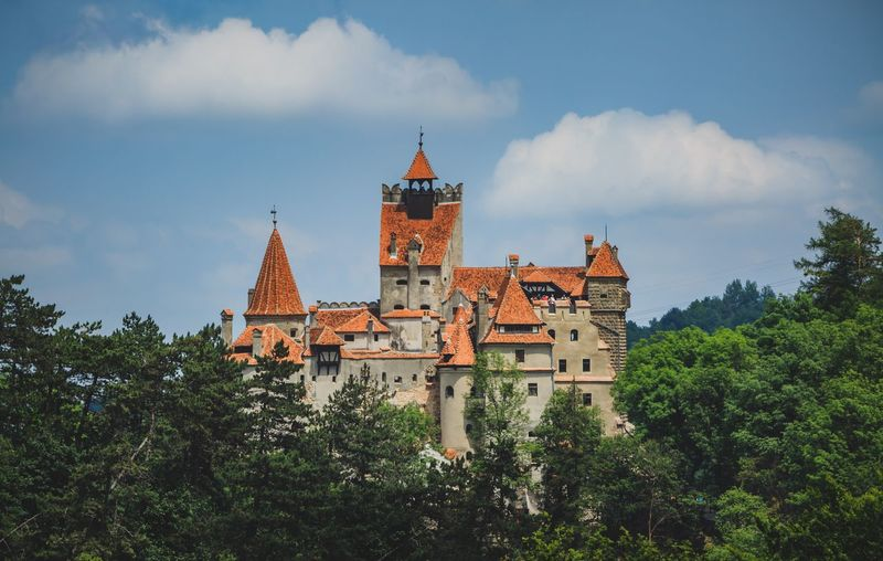 Dracula castle of Romania Romania Castle Built Structure Architecture Building Exterior Sky Tree Cloud - Sky Plant Building Place Of Worship Religion Outdoors Travel Low Angle View Travel Destinations