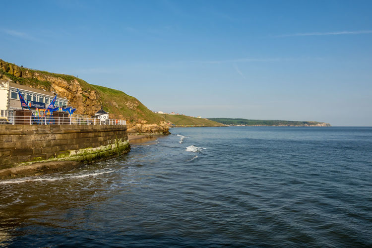 Whitby Whitby Harbour Whitby View Whitby North Yorkshire North Yorkshire North Yorkshire Coast Yorkshire Yorkshire Coast Yorkshire Coastline Seaside Seaside Town Whitby Pier No People Tranquil Scene Scenics - Nature Sky Sea Water Waterfront Mountain Land Beach Outdoors Day Built Structure