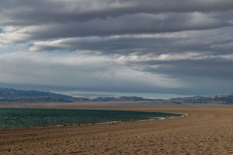 Mongolia Cloud - Sky Sky Beauty In Nature Mountain Scenics - Nature Land Water Tranquil Scene Nature Tranquility Beach Non-urban Scene Sand Environment Day Mountain Range Sea Overcast No People