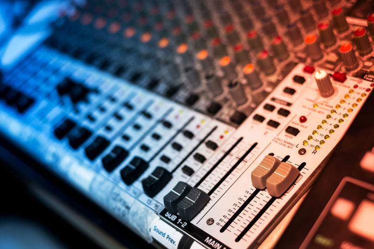 Close-up of sound mixer at studio
