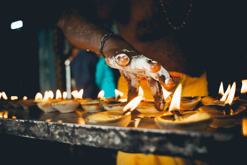 Burning Candle Close-up Diwali Diya - Oil Lamp Flame Food Glowing Heat - Temperature Holding Human Body Part Human Hand Illuminated Indoors  Night Oil Lamp One Person People Preparation  Real People Religion The Photojournalist - 2018 EyeEm Awards The Still Life Photographer - 2018 EyeEm Awards